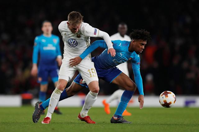 Soccer Football - Europa League Round of 32 Second Leg - Arsenal vs Ostersunds FK - Emirates Stadium, London, Britain - February 22, 2018 Arsenal's Alex Iwobi in action with Ostersunds FK's Dennis Widgren Action Images via Reuters/Peter Cziborra
