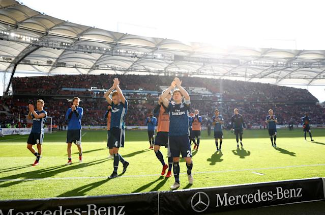 Soccer Football - Bundesliga - VfB Stuttgart vs Hamburger SV - Mercedes-Benz Arena, Stuttgart, Germany - March 31, 2018 Hamburg's Gotoku Sakai and team mates applaud the fans at the end of the match REUTERS/Kai Pfaffenbach DFL RULES TO LIMIT THE ONLINE USAGE DURING MATCH TIME TO 15 PICTURES PER GAME. IMAGE SEQUENCES TO SIMULATE VIDEO IS NOT ALLOWED AT ANY TIME. FOR FURTHER QUERIES PLEASE CONTACT DFL DIRECTLY AT + 49 69 650050
