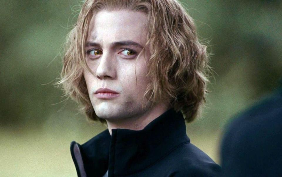 """<p>This is the hill I will die on: Jasper Hale is the most swoon-worthy character in the entire film series. Don't even talk to me about Jacob or Edward while Jasper is around. He's got the accent, the strawberry blonde waves, and he's super cute with Alice. Did I mention he knows how to deal with newborns? I digress. To achieve those post-battle tousled waves, spritz in some <a href=""""https://www.dermstore.com/product_Dry+Texturizing+Spray+_77266.htm"""" rel=""""nofollow noopener"""" target=""""_blank"""" data-ylk=""""slk:Oribe Dry Texturizing Spray"""" class=""""link rapid-noclick-resp"""">Oribe Dry Texturizing Spray</a> ($48). Now gaze longingly out the window to really perfect the look.</p>"""