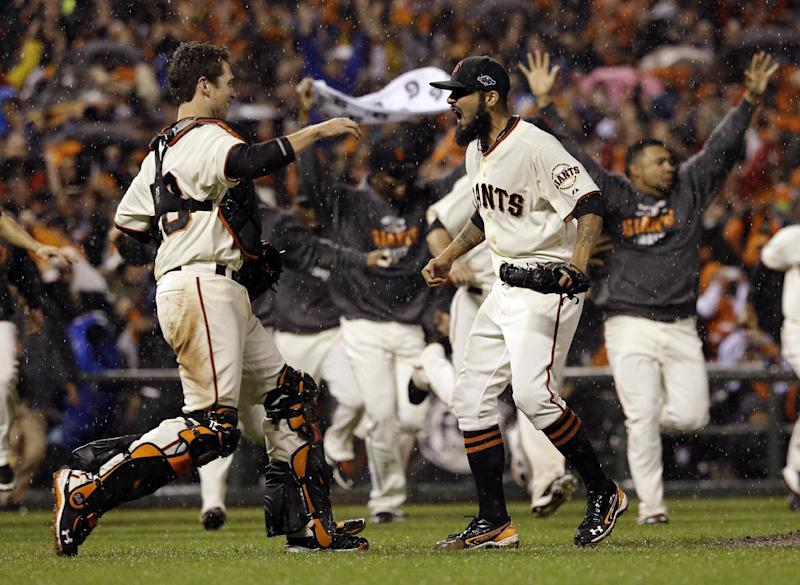 San Francisco Giants relief pitcher Sergio Romo and catcher Buster Posey react after the final out in Game 7 of baseball's National League championship series against the St. Louis Cardinals Monday, Oct. 22, 2012, in San Francisco. The Giants won 9-0 to win the series. (AP Photo/David J. Phillip)