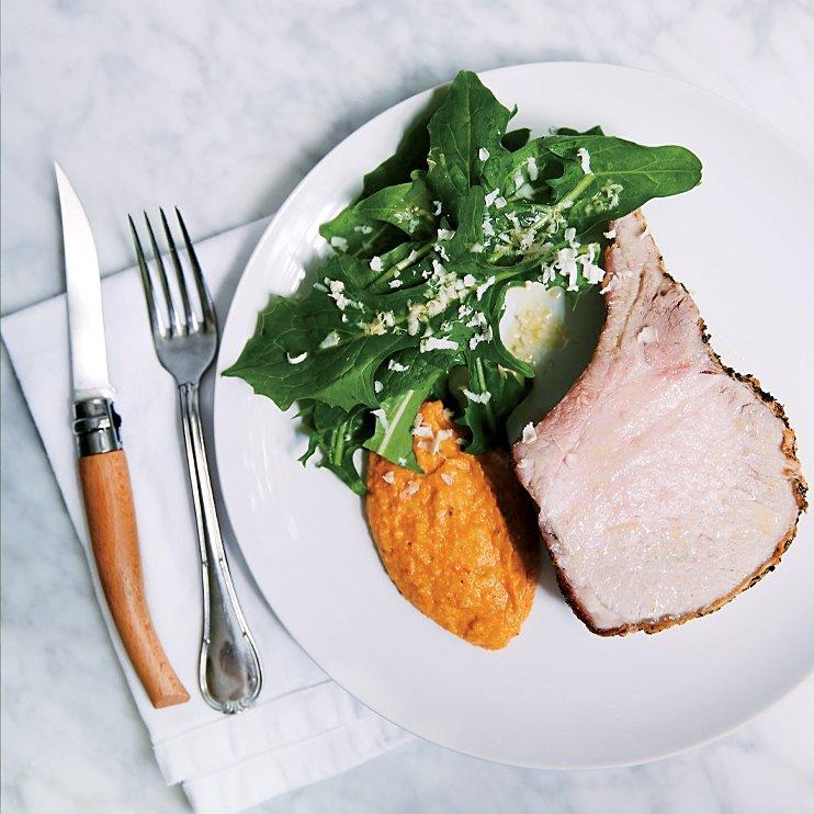 """<p>Romesco, a traditional Catalonian sauce with almonds and red bell pepper, is the inspiration for Mike Lata's squash puree, which does double duty as a side dish and a flavorful sauce for the pork.</p><p><a href=""""https://www.foodandwine.com/recipes/roast-pork-acorn-squash-romesco-puree"""">GO TO RECIPE</a></p>"""