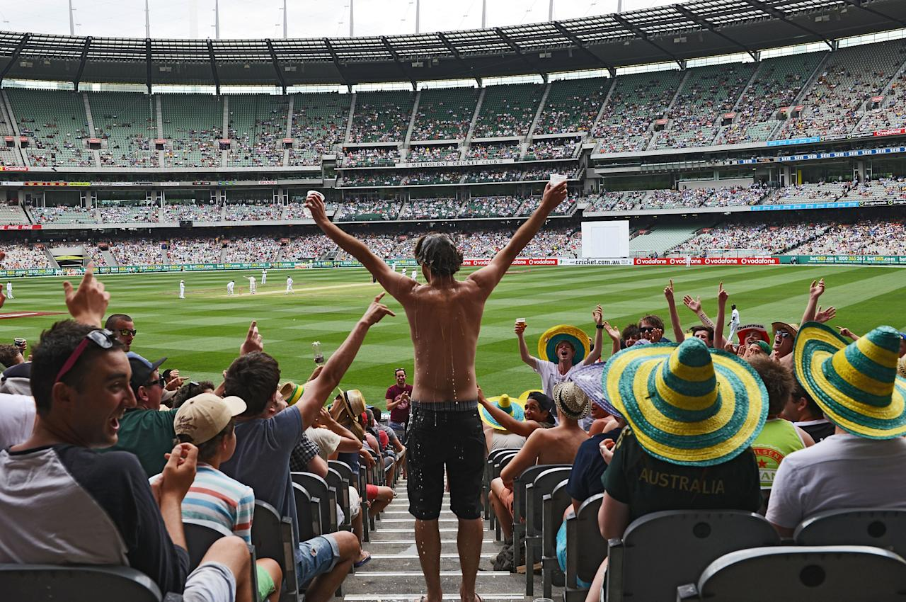 MELBOURNE, AUSTRALIA - DECEMBER 27:  A fan cheers during day two of the Second Test match between Australia and Sri Lanka at Melbourne Cricket Ground on December 27, 2012 in Melbourne, Australia.  (Photo by Vince Caligiuri/Getty Images)