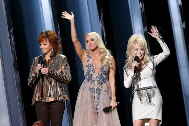 Reba McEntire, Carrie Underwood, Dolly Parton speak onstage during the 53rd annual CMA Awards at the Music City Center on November 13, 2019 in Nashville, Tennessee. (Terry Wyatt/Getty Images)