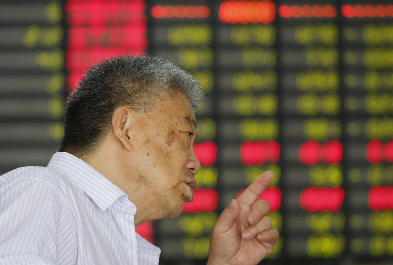 An investor gestures at a private securities company in Shanghai, China Friday, July 26, 2013. Asian stock markets floundered Friday as China pressed ahead with industrial restructuring that is contributing to slowing growth in the world's No. 2 economy. (AP Photo)