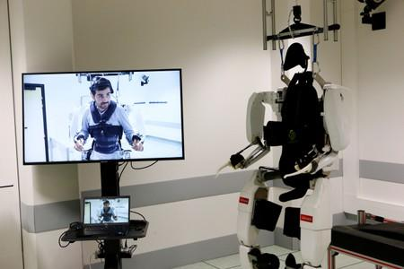 The pioneering four-limb robotic system, or exoskeleton, that is commanded and controlled by signals from the patient's brain is seen following a news conference at the French research center Clinatec in Grenoble