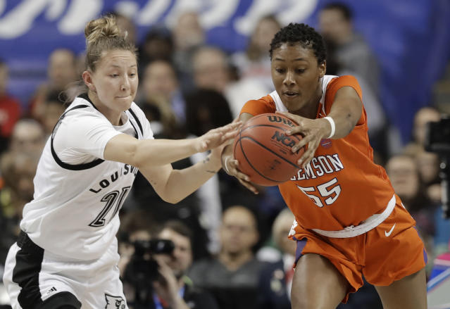 Louisville's Kylee Shook (21) and Clemson's Tylar Bennett (55) chase a loose ball during the first half of an NCAA college basketball game in the Atlantic Coast Conference women's tournament in Greensboro, N.C., Friday, March 8, 2019. (AP Photo/Chuck Burton)