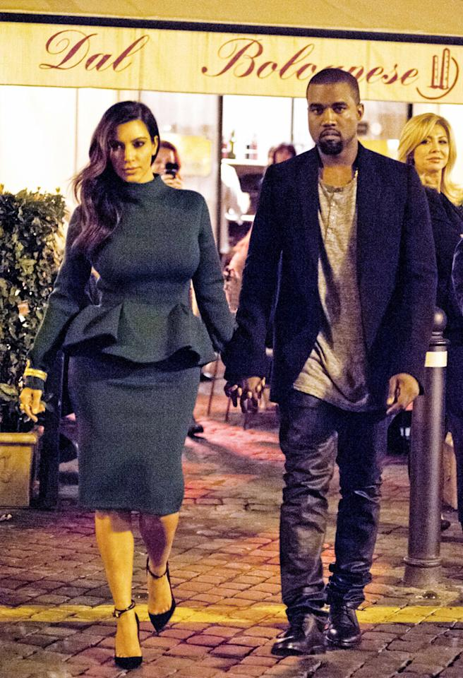 October 18, 2012: Kanye West treats birthday girl/girlfriend Kim Kardashian to dinner in Rome, Italy following a day of shopping.