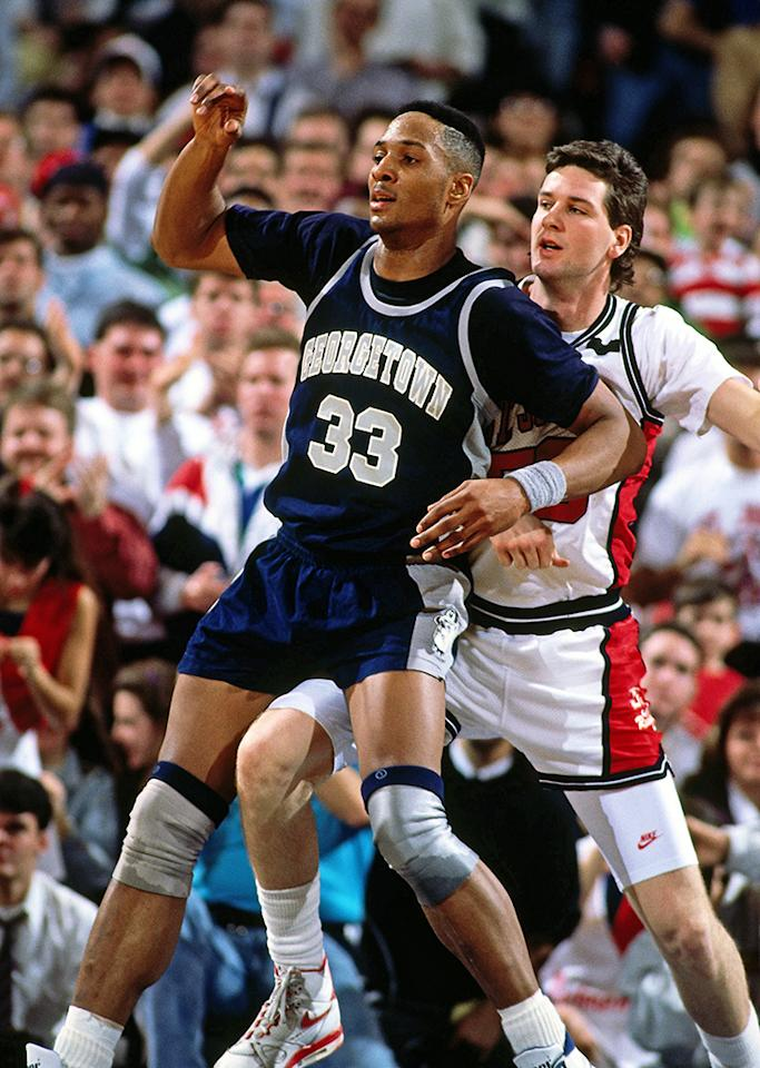 Alonzo Mourning #33 of the Georgetown Hoyas posts up against St. John's Red Men circa 1989 at Madison Square Garden in New York City . NOTE TO USER: User expressly acknowledges and agrees that, by downloading and/or using this photograph, user is consenting to the terms and conditions of the Getty Images License Agreement.  Mandatory Copyright Notice: Copyright 1989 NBAE (Photo by Nathaniel S. Butler/NBAE via Getty Images)