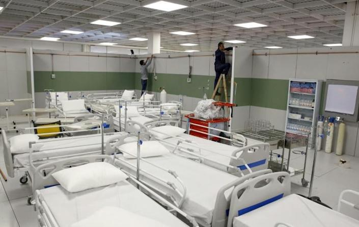 To tackle the number of coronavirus cases, Iran has set up makeshift hospitals like this one in the Iran Mall, a vast shopping and leisure complex northwest of Tehran (AFP Photo/-)
