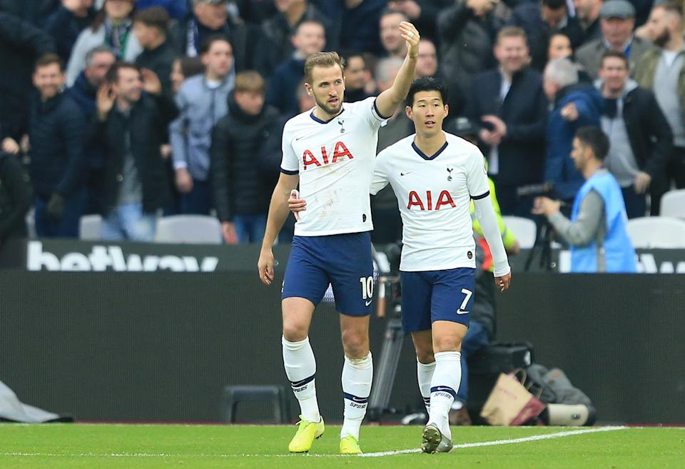 LONDON, ENGLAND - NOVEMBER 23: Harry Kane of Tottenham Hotspur celebrates with Heung-Min Son of Tottenham Hotspur after scoring his team's third goal  during the Premier League match between West Ham United and Tottenham Hotspur at London Stadium on November 23, 2019 in London, United Kingdom. (Photo by Stephen Pond/Getty Images)