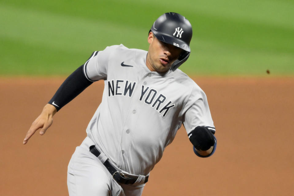 Sep 29, 2020; Cleveland, Ohio, USA; New York Yankees shortstop Gleyber Torres (25) rounds third base while scoring against the Cleveland Indians in the fourth inning at Progressive Field. Mandatory Credit: David Richard-USA TODAY Sports