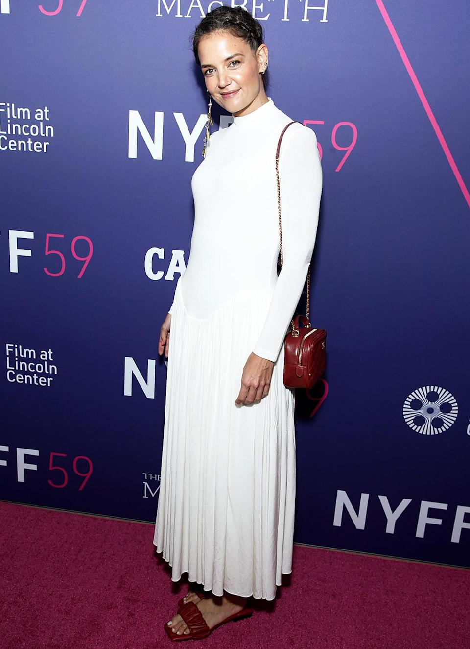 <p>Katie Holmes poses on the red carpet at the opening night screening of <em>The Tragedy of Macbeth </em>on Sept. 24 during the New York Film Festival.</p>