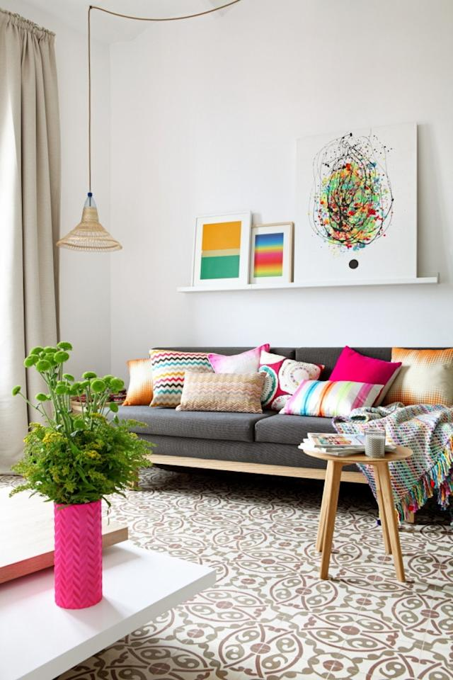 """<p>Filled with pops of neon—and we do mean <em>neon</em>—green, this apartment is incredibly photogenic (plus there are floor-to-ceiling mirrors for #OOTD). But beyond its looks, the two-bedroom space has all of the amenities you'd need, from a fully-equipped kitchen to air-conditioning, family-friendly items like pack 'n plays and high chairs, and Wi-Fi. There's also a narrow balcony, just big enough to enjoy morning coffee on. As for the location, it's just a 10-minute walk from <a href=""""https://www.cntraveler.com/activities/barcelona/nova-icaria-and-bogatell?mbid=synd_yahoo_rss"""" target=""""_blank"""">Bogatell beach</a>, and 25-minute walk from La Sagrada Familia. Don't want to walk? The Bogatell Metro station is steps away.</p> <p><strong>Book Now:</strong> <a href=""""http://airbnb.pvxt.net/BkM4L"""" rel=""""nofollow"""" target=""""_blank"""">From $110 per night, airbnb.com</a></p>"""