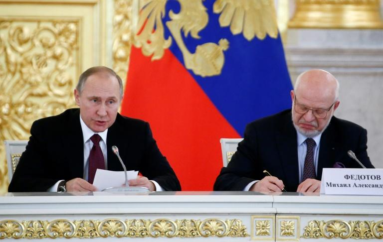 Russia's President Vladimir Putin delivers a speech during a session of the human rights council as its chairman Mikhail Fedotov takes notes back in 2016. Fedotov is now being removed from the body (AFP Photo/SERGEI KARPUKHIN)