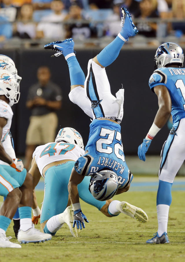 Carolina Panthers' Christian McCaffrey (22) is upended by Miami Dolphins' Kiko Alonso (47) in the first half of a preseason NFL football game in Charlotte, N.C., Friday, Aug. 17, 2018. (AP Photo/Nell Redmond)
