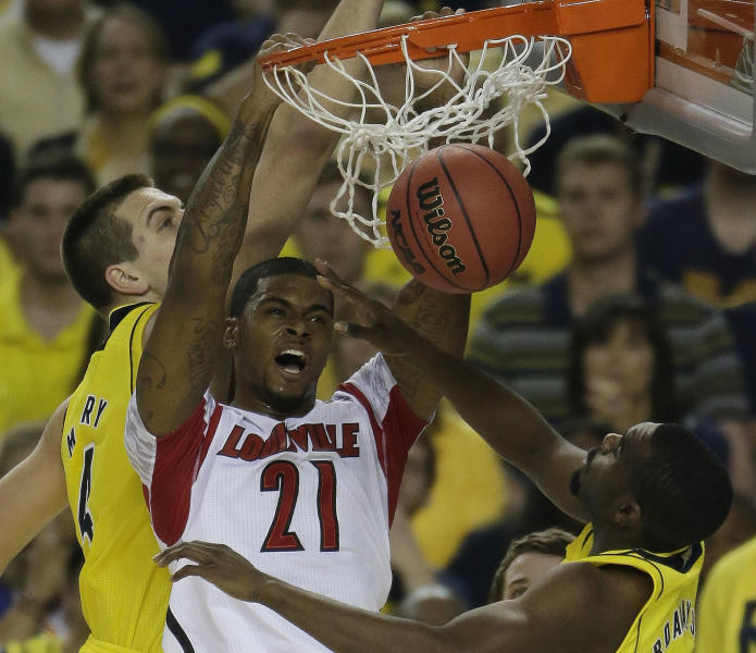 Louisville forward Chane Behanan (21) dunks against the Michigan during the first half of the NCAA Final Four tournament college basketball championship game Monday, April 8, 2013, in Atlanta. (AP Photo/Chris O'Meara)