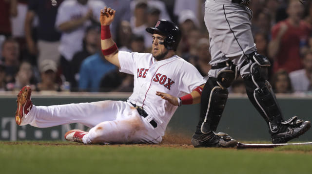 Boston Red Sox's Michael Chavis scores on a single by Eduardo Nunez during the fifth inning of a baseball game against the Chicago White Sox at Fenway Park in Boston, Monday, June 24, 2019. (AP Photo/Charles Krupa)