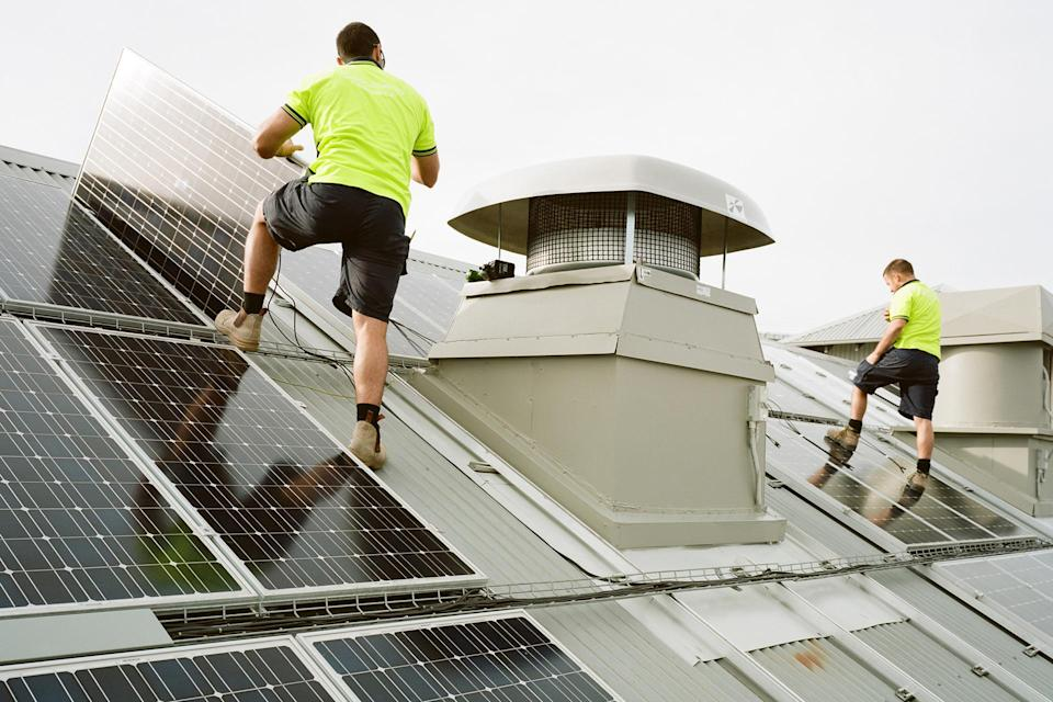 installing solar panels credit: Michael Hall. Getty Images.