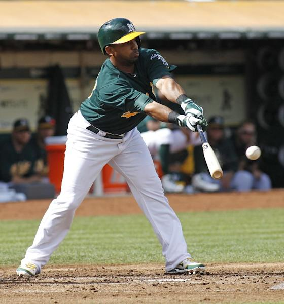 Oakland Athletics' Alberto Callaspo hits an RBI single against the Minnesota Twins during the first inning of a baseball game, Saturday, Sept. 21, 2013, in Oakland, Calif. (AP Photo/George Nikitin)