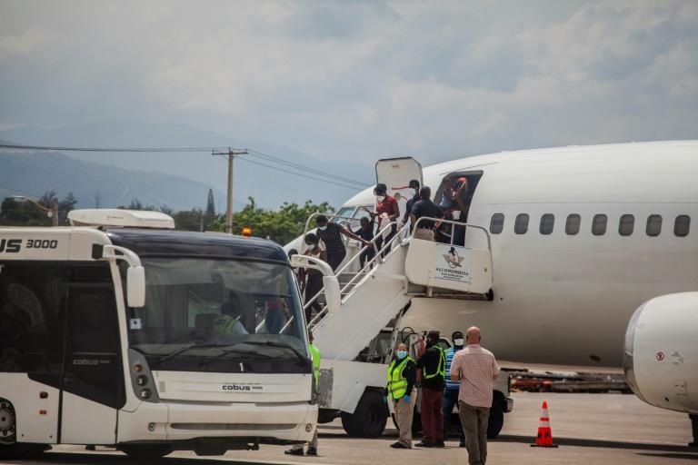 Haitians deported from the United States, some of them after harrowing months-long journeys, arrive at the airport in Port-au-Prince (AFP/Richard Pierrin)