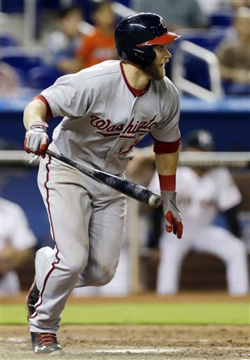 Washington Nationals' Bryce Harper hits an RBI single during the ninth inning of a baseball game against the Miami Marlins in Miami, Wednesday, April 17, 2013. The Nationals won 6-1. (AP Photo/J Pat Carter)