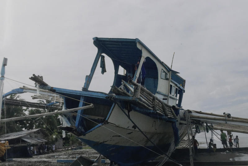 In this undated June 2019 handout photo provided by Arlinda dela Torre via the Department of Agriculture, the damaged Filipino fishing boat F/B Gimver 1 sits on the shore at San Jose, Occidental Mindoro province, Philippines. China recently acknowledged its fishing vessel hit a Filipino boat in the disputed South China Sea in an incident that prompted an outcry in the Philippines but denies the collision was intentional. The Philippines has filed a diplomatic protest after Filipino fishermen said a Chinese vessel rammed their anchored boat on Sunday night then abandoned them as the boat sank in the Reed Bank. (Department of Agriculture via AP)