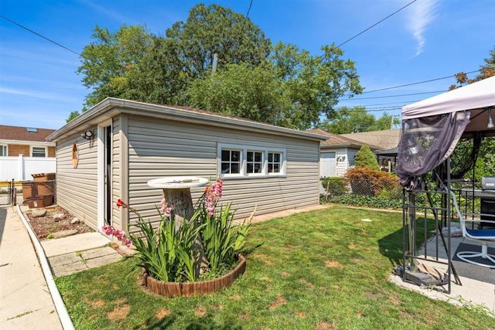 the detached garage and small backyard at a house for sale near chicago