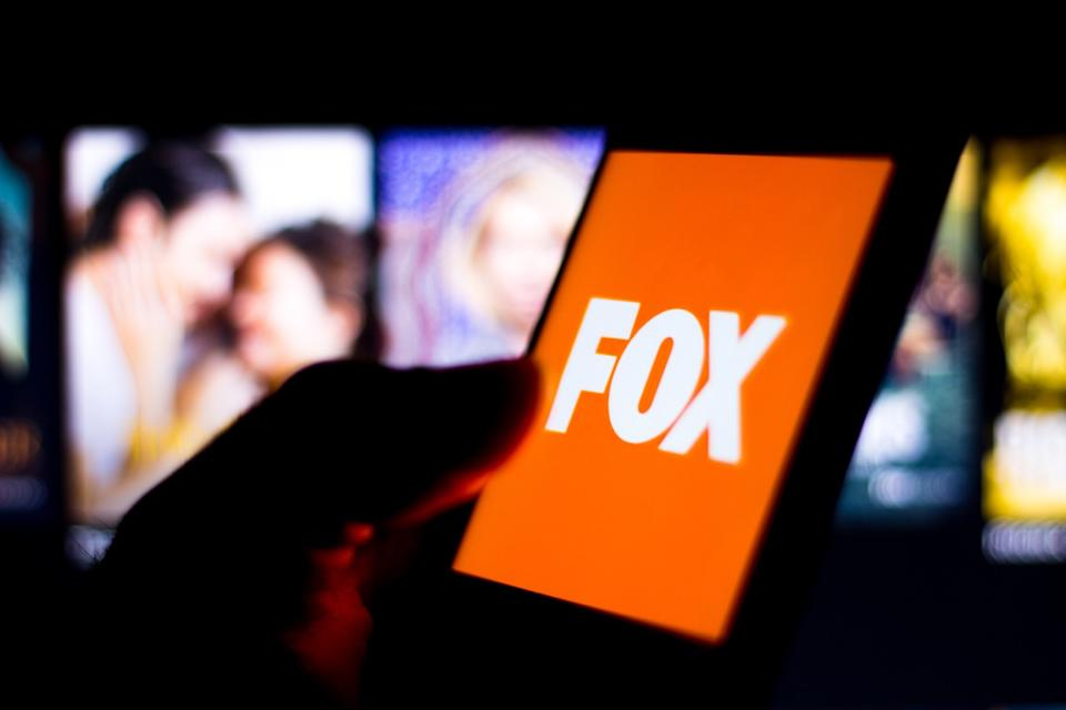Photo illustration the Fox Broadcasting Company logo seen displayed on a smartphone.