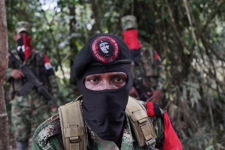 Yerson, commander of the National Liberation Army (ELN), talks to Reuters in the northwestern jungles in Colombia, August 30, 2017. Picture taken August 30, 2017. REUTERS/Federico Rios