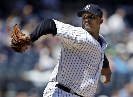 New York Yankees starting pitcher CC Sabathia delivers against the Cleveland Indians in the fourth inning of a baseball game at Yankee Stadium in New York, Wednesday, June 5, 2013. (AP Photo/Kathy Willens)