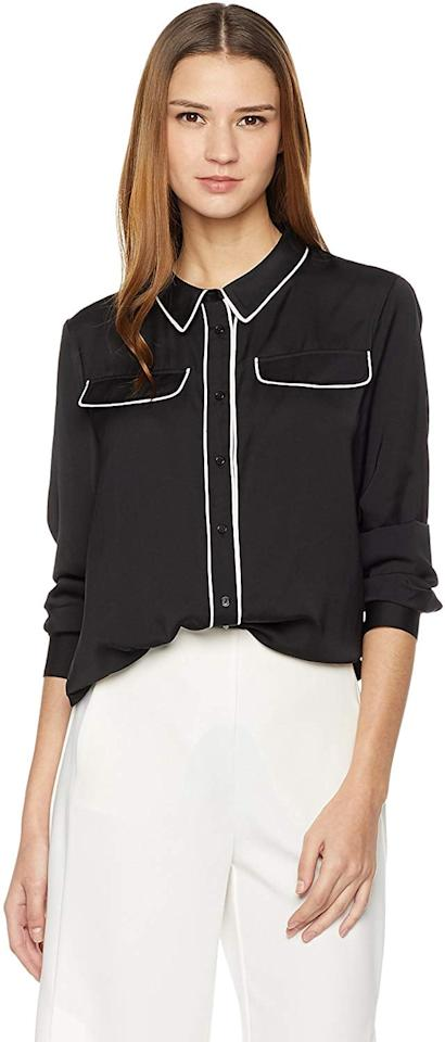 """<p>We like the piping on this <a href=""""https://www.popsugar.com/buy/Essentialist-Flap-Pocket-Button-Down-Blouse-506839?p_name=Essentialist%20Flap%20Pocket%20Button-Down%20Blouse&retailer=amazon.com&pid=506839&price=12&evar1=fab%3Aus&evar9=46805128&evar98=https%3A%2F%2Fwww.popsugar.com%2Fphoto-gallery%2F46805128%2Fimage%2F46806286%2FEssentialist-Flap-Pocket-Button-Down-Blouse&list1=shopping%2Cfall%20fashion%2Camazon%2Ctops&prop13=api&pdata=1"""" rel=""""nofollow"""" data-shoppable-link=""""1"""" target=""""_blank"""" class=""""ga-track"""" data-ga-category=""""Related"""" data-ga-label=""""https://www.amazon.com/Essentialist-Womens-Pocket-Button-Contrast/dp/B078JSQZ9X/ref=sr_1_135?dchild=1&amp;qid=1571954363&amp;refinements=p_n_feature_eighteen_browse-bin%3A16926165011&amp;rnid=2368343011&amp;s=apparel&amp;sr=1-135&amp;th=1&amp;psc=1"""" data-ga-action=""""In-Line Links"""">Essentialist Flap Pocket Button-Down Blouse </a> ($12).</p>"""