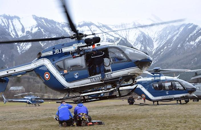 A gendarmerie helicopter gets ready to take off in a field where rescuers are headquartered on March 24, 2015 in Seyne, France, after a Germanwings Airbus A320 crashed in the Alps, killing all 150 people on board (AFP Photo/Anne-Christine Poujoulat)