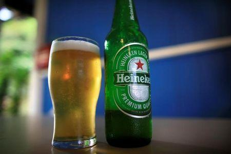 Cheers! Heineken toasts rise in half-year operating profit to £1.6 billion