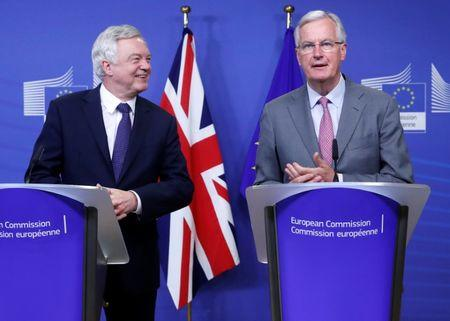 UK Secretary of State for Exiting the European Union Davis and the European Commission's Chief Brexit Negotiator Barnier talk to reporters in Brussels
