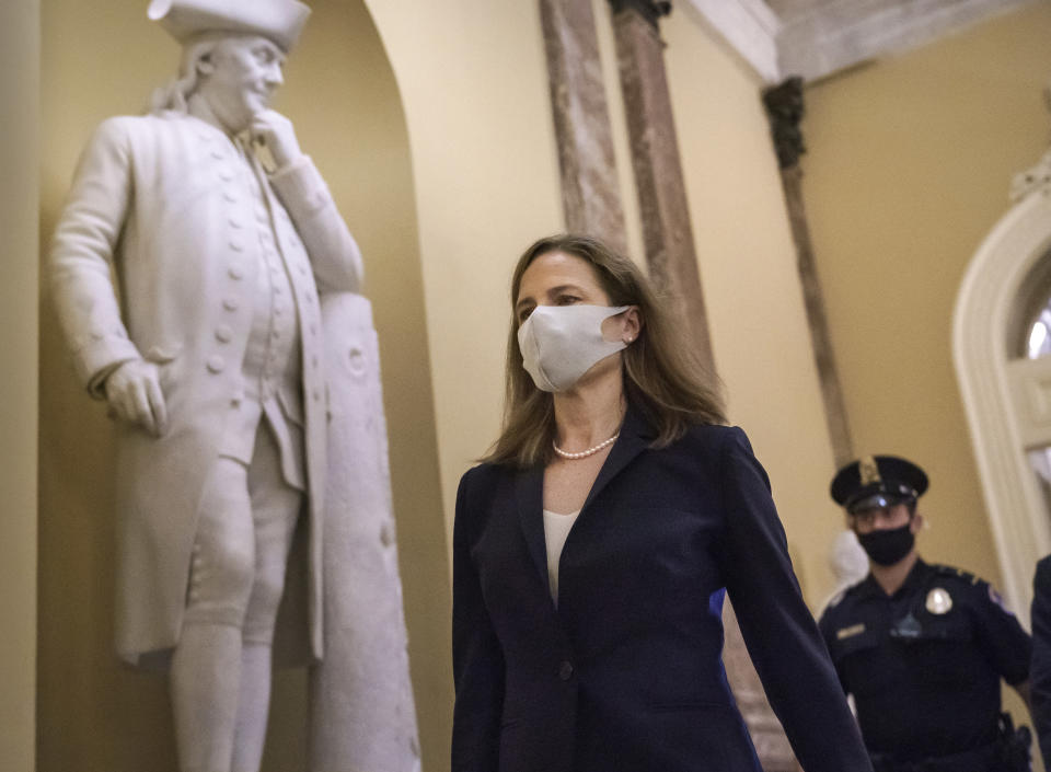 Judge Amy Coney Barrett, President Donald Trump's nominee for the Supreme Court, arrives for closed meetings with senators, at the Capitol in Washington, Wednesday, Oct. 21, 2020. (AP Photo/J. Scott Applewhite)
