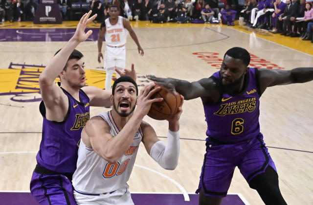 New York Knicks center Enes Kanter, center, tries to shoot as Los Angeles Lakers center Ivica Zubac, left, and guard Lance Stephenson defend during the first half of an NBA basketball game Friday, Jan. 4, 2019, in Los Angeles. (AP Photo/Mark J. Terrill)