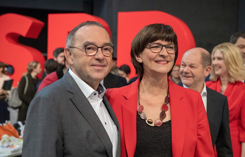 06 December 2019, Berlin: Norbert Walter-Borjans (l-r), candidate for the party chairmanship of the SPD, stands next to Saskia Esken, candidate for the party chairmanship of the SPD, as well as Olaf Scholz, deputy chairman of the SPD and Federal Minister of Finance, and Manuela Schwesig (SPD), Prime Minister of Mecklenburg-Western Pomerania, at the SPD federal party conference. From 06 December 2019 to 08 December 2019, the SPD wants to elect a new leadership team at the party conference. Photo: Bernd von Jutrczenka/dpa (Photo by Bernd von Jutrczenka/picture alliance via Getty Images)