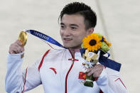 Liu Yang, of China, celebrates after winning the gold medal on the rings during the artistic gymnastics men's apparatus final at the 2020 Summer Olympics, Monday, Aug. 2, 2021, in Tokyo, Japan. (AP Photo/Gregory Bull)
