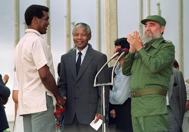 African National Congress (ANC) President Nelson Mandela (C) greets Cuban Olympic boxer Teofilo Stevenson (L) 25 July 1991 in Havana. Stevenson --who won 301 of the 321 fights he took part-- died of a heart attack at the age of 60 in Havana on June 11, 2012. (FILM) AFP PHOTO/RAFAEL PEREZRAFAEL PEREZ/AFP/GettyImages