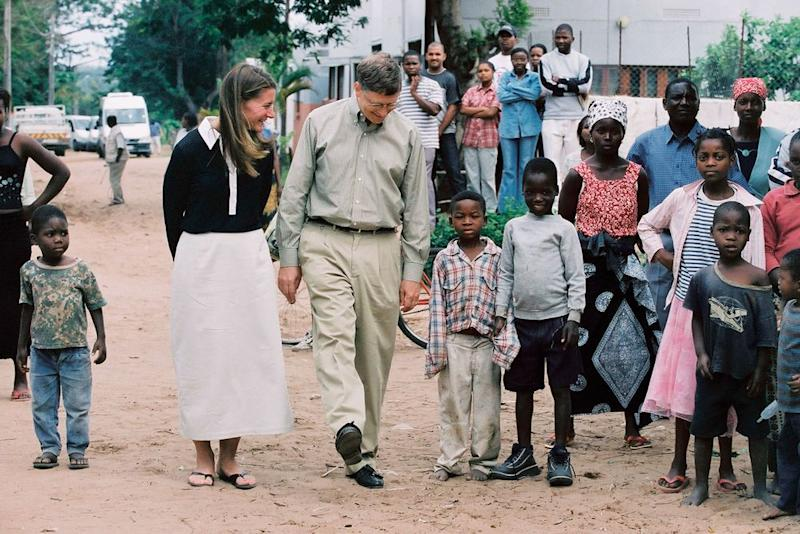 """In Manhiça, Mozambique in 2003. """"Melinda would sit on the ground, talking woman to woman about the things that mothers care about,"""" recalls one ally who joined the trip. """"She has this remarkable ability to connect."""" 