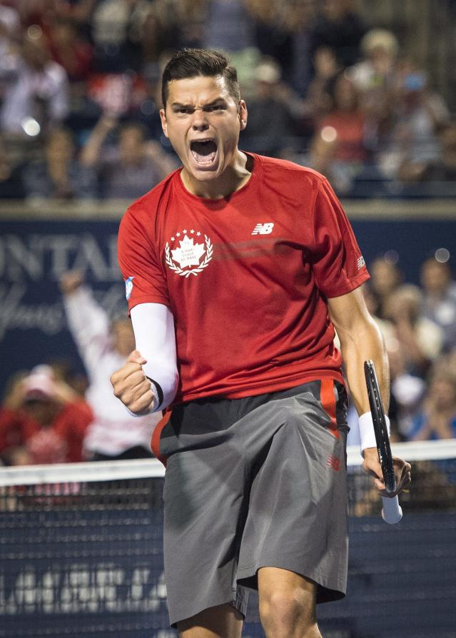 Milos Raonic, of Canada, reacts after defeating Jack Sock, of the USA, at the Rogers Cup tennis tournament, Wednesday, Aug. 6, 2014 in Toronto. (AP Photo/The Canadian Press, Darren Calabrese)