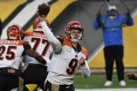 Cincinnati Bengals quarterback Joe Burrow (9) throws a pass during the first half of an NFL football game against the Pittsburgh Steelers in Pittsburgh, Sunday, Nov. 15, 2020. (AP Photo/Don Wright)