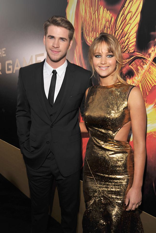 "Liam Hemsworth and Jennifer Lawrence arrive at the world premiere of ""The Hunger Games"" in Los Angeles, California."