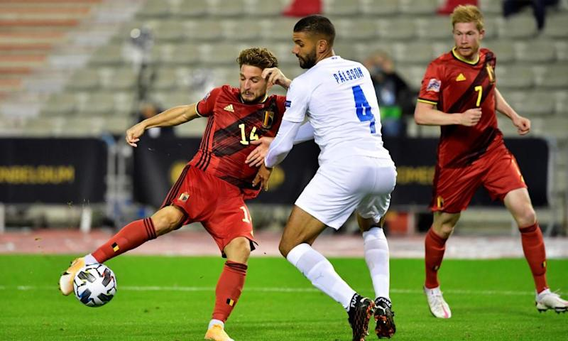 Dries Mertens scores for Belgium in their 5-1 thrashing of Iceland on Tuesday. They top England's Nations League group and visit Wembley on 11 October.