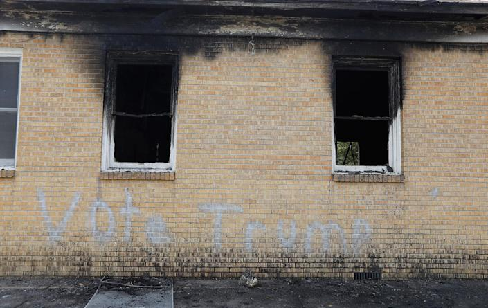"""<p>""""Vote Trump"""" is spray painted on the side of the fire damaged Hopewell M.B. Baptist Church in Greenville, Miss., Wednesday, Nov. 2, 2016. (AP Photo/Rogelio V. Solis) </p>"""