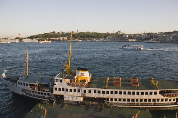 turkey, istanbul, sultanahmet. bosphorous passenger ferry moored at sunset with the hagia sophia behind.
