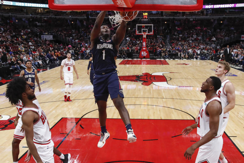 Oct 9, 2019; Chicago, IL, USA; New Orleans Pelicans forward Zion Williamson (1) dunks the ball against the Chicago Bulls during the second half at United Center. Mandatory Credit: Kamil Krzaczynski-USA TODAY Sports