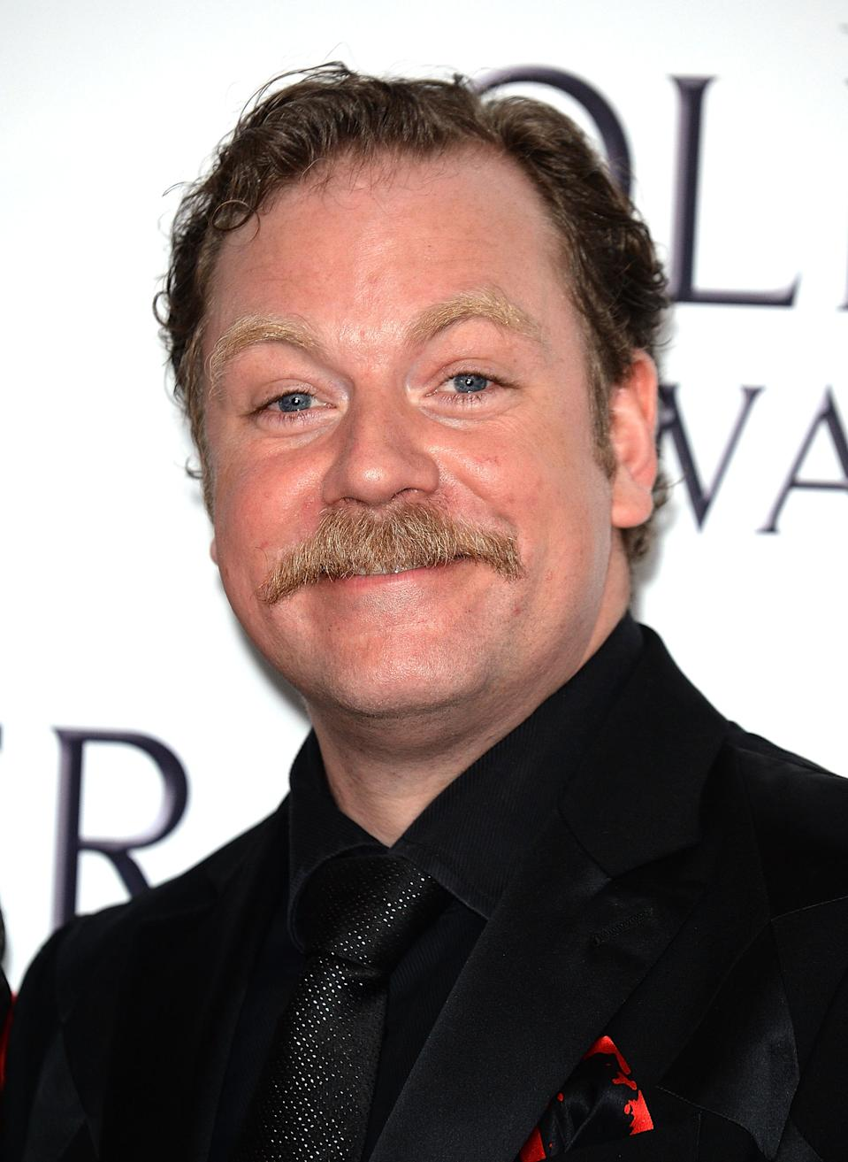 LONDON, ENGLAND - APRIL 09: Rufus Hound poses in the winners room at The Olivier Awards 2017 at Royal Albert Hall on April 9, 2017 in London, England. (Photo by Eamonn M. McCormack/Getty Images)