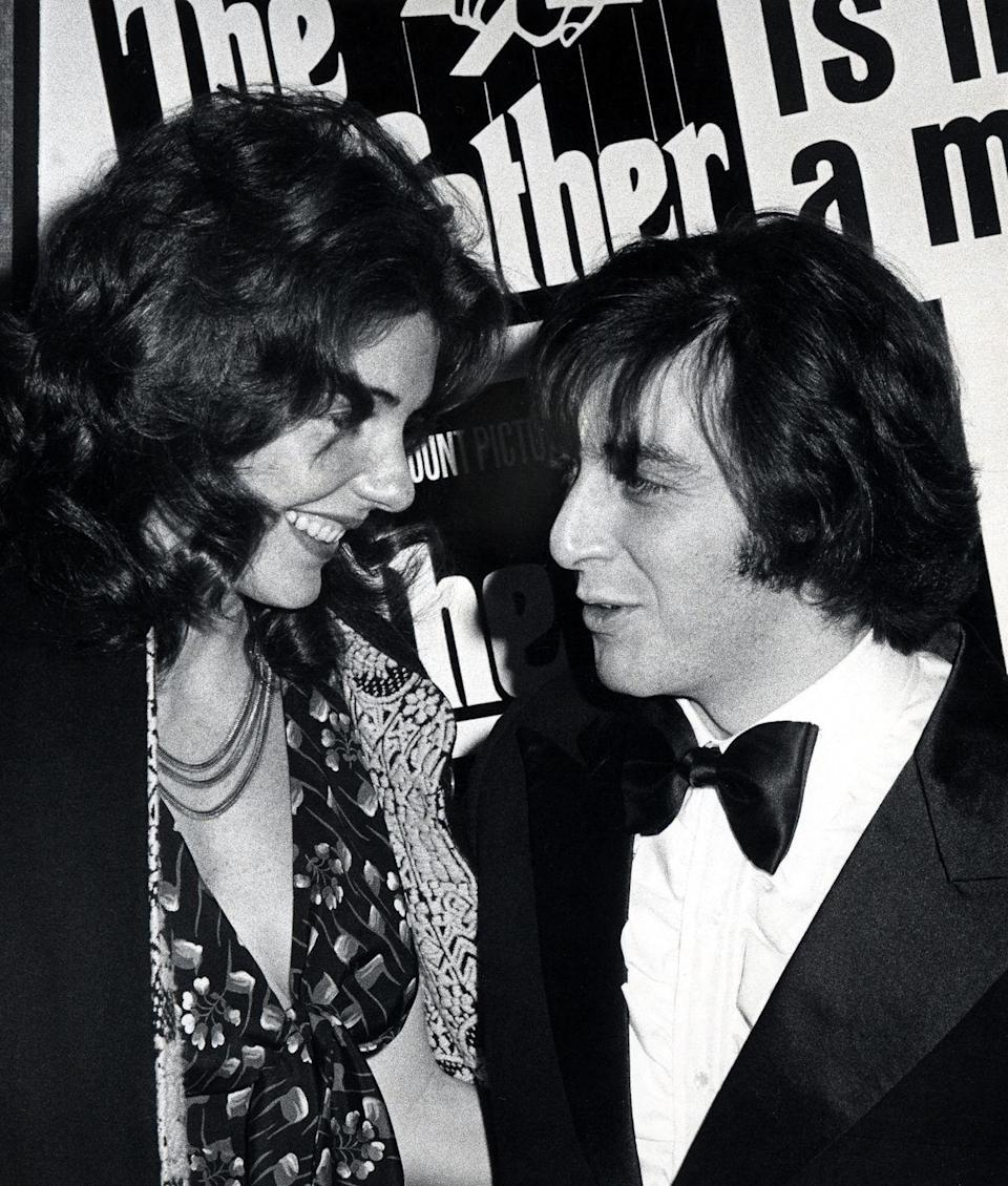 <p>Jill Clayburg and Al Pacino share a smile at the New York premiere of <em>The Godfather</em> in 1972. Star Marlon Brando used cue cards when recording his scenes for the classic crime film.</p>