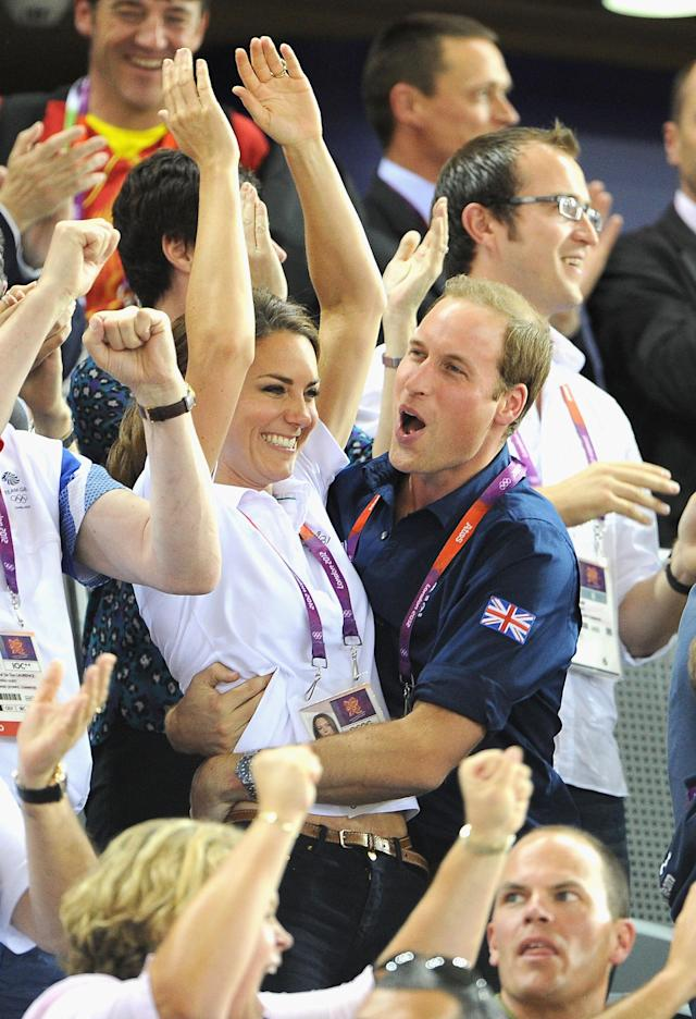 Catherine, Duchess of Cambridge and Prince William, Duke of Cambridge embrace after Philip Hindes, Jason Kenny and Sir Chris Hoy of Great Britain win the gold and a new world record in the Men's Team Sprint Track Cycling final during Day 6 of the London 2012 Olympic Games at Velodrome on August 2, 2012 in London, England. (Photo by Pascal Le Segretain/Getty Images)